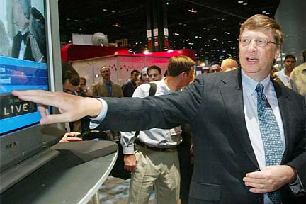 Bill Gates demonstrating Microsoft TV Foundation Edition at the NCTA 2003 show. Photo copyright Microsoft.