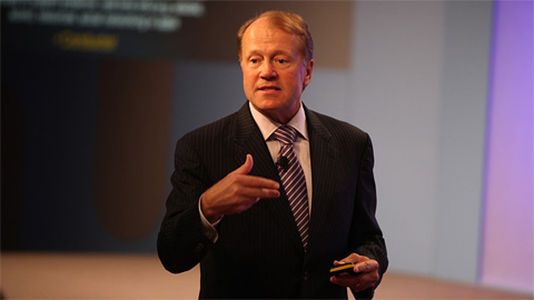 John Chambers, the chief executive of Cisco, announcing Videoscape at CES 2011. Photo: Cisco. All rights reserved.