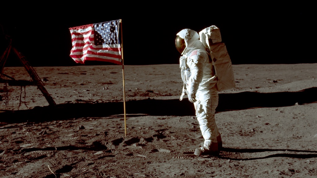 Buzz Aldrin with American flag on the moon.